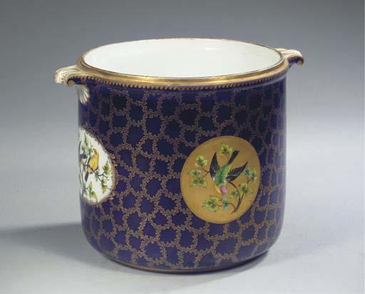 A Meissen porcelain dark blue-ground ornithological two-handled bottle cooler