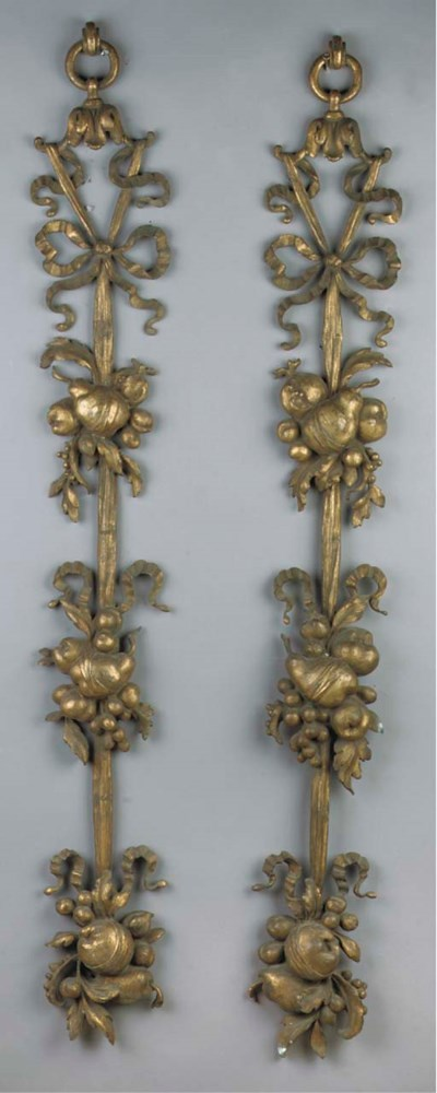 A pair of gilt-brass ornaments
