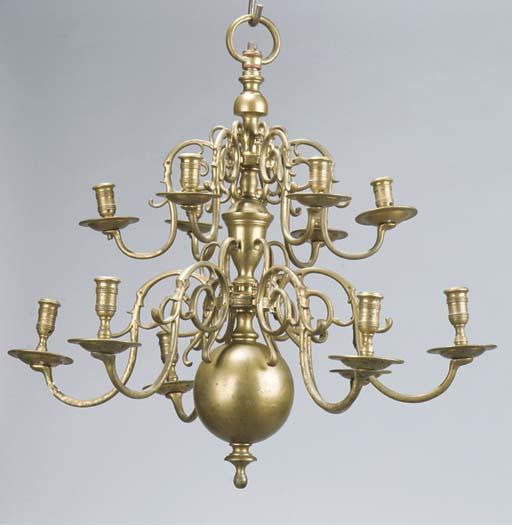 A Dutch brass twelve-light two-tier chandelier
