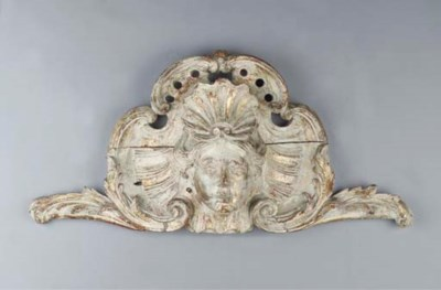 A GREY-PAINTED CARVED WOOD ORN