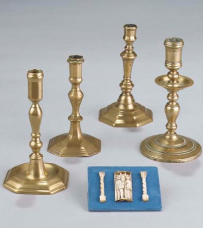 Four various brass candlestick