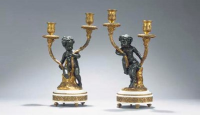 A pair of Napoleon III gilt an