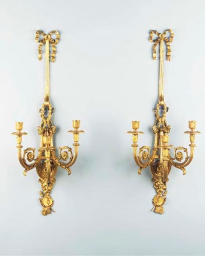 A pair of ormolu three-light w