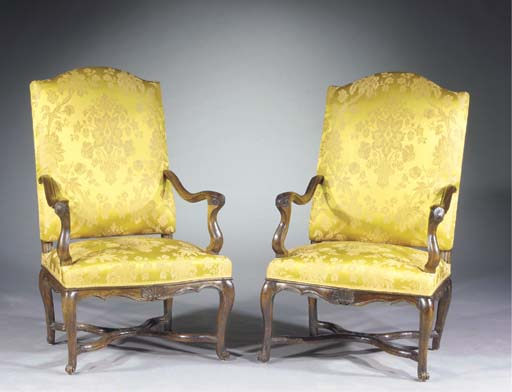 A pair of regence stained beechwood fauteuils