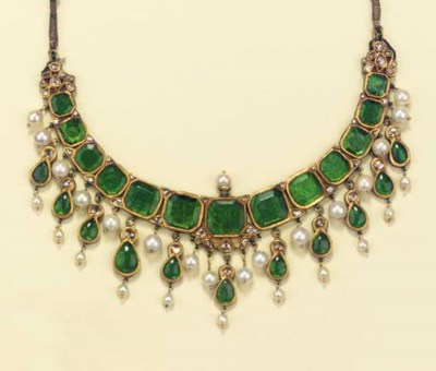 AN INDIAN FOILED EMERALD, CULT