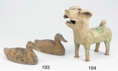 A pair of grey Pottery duck-fo