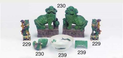 A pair of green-glazed models