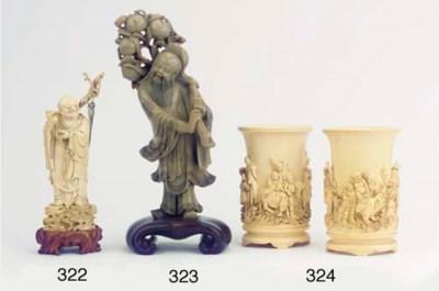 A pair of ivory brushpots, bit