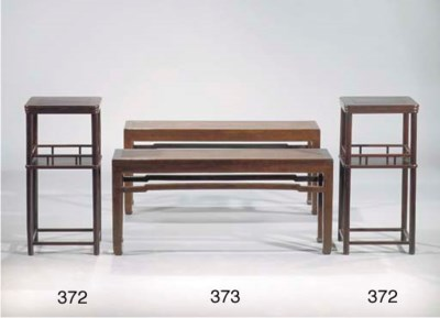 A pair of lacquered benches