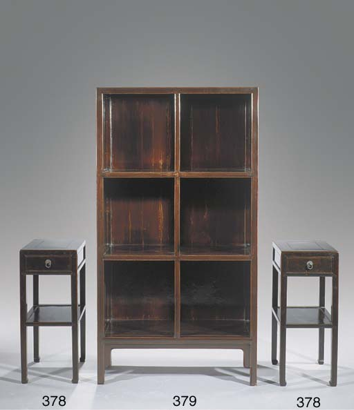 A lacquered elm bookcase