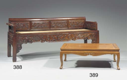 A stained wood settee
