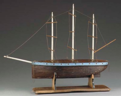 A RIGGED WOODEN MODEL OF A THR