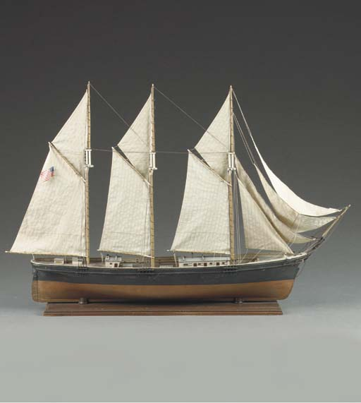 A WOODEN DISPLAY MODEL OF A THREE MASTED GAFF RIGGED SCHOONER