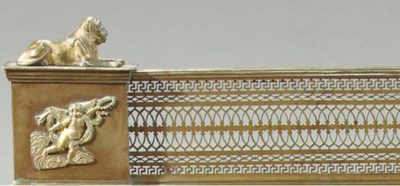 A FRENCH GILT-BRASS FENDER
