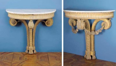 A pair of german giltwood cons