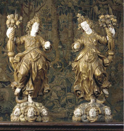 A pair of polychrome and gilt
