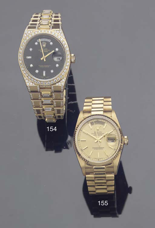 AN 18K GOLD AUTOMATIC WATER RE