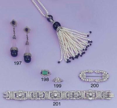 AN EMERALD, ONYX AND DIAMOND R
