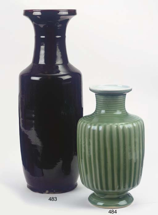 A black-glazed rouleau vase