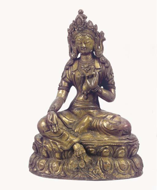 A Tibetan repousse bronze figu