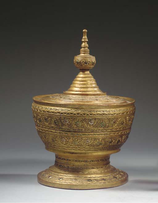 A Burmese gilt-papier mache vessel and three manuscript pages
