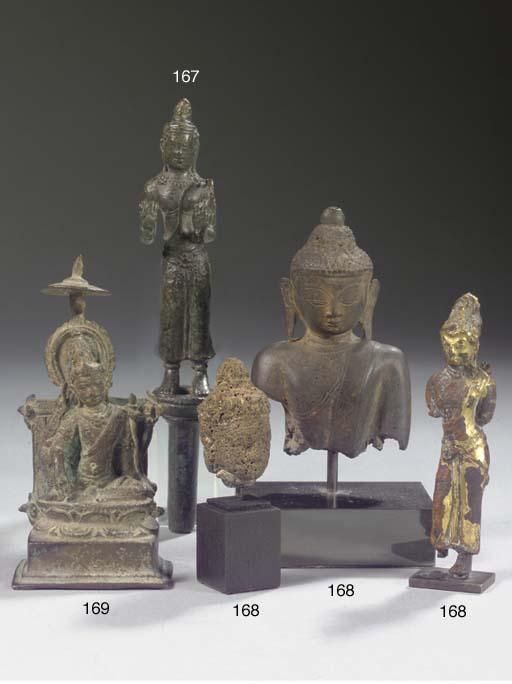 A Javanese, Srivijaya style, gilt-bronze figure of Avalokiteshvara, a Javanese stone head of Buddha Sakyamuni and a Burmese torso of Buddha Sakyamuni