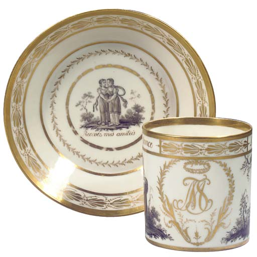 A large Paris gilt monogrammed allegorical gallant cabinet cup and saucer