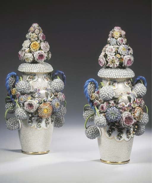 A pair of Jacob Petit-style gilt snowball or gueldre-rose-encrusted vases and covers