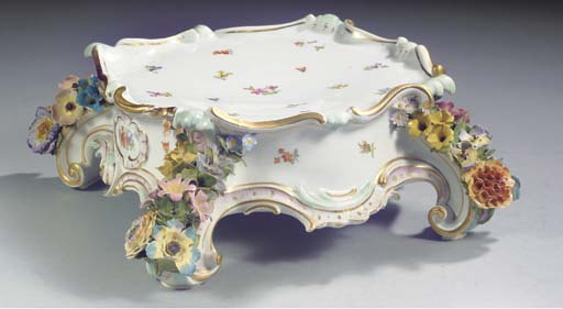 A Meissen flower-encrusted quadruped stand