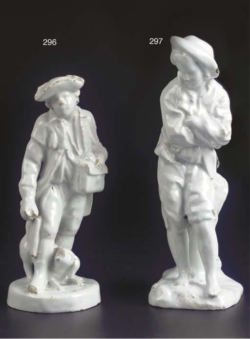 A white Delft figure of a vagabond or messenger
