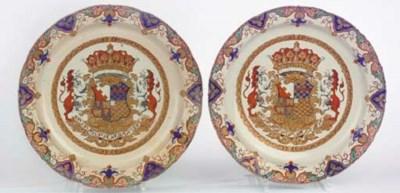 A pair of Delft doré dated arm