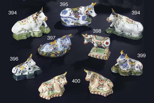A small Dutch Delft polychrome model of a recumbent cow