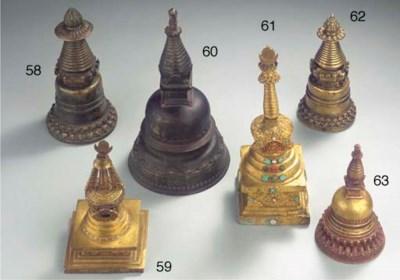 a nepalese gilt-bronze caitya
