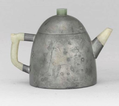 A PEWTER-ENCASED YIXING TEAPOT