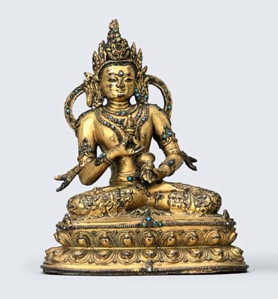 A TIBETAN GILT-BRONZE FIGURE O