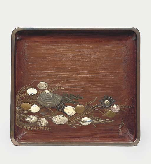 A wood and lacquer tray