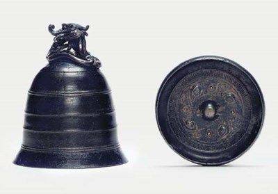 A bronze bell and mirror