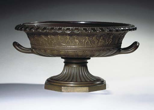 A DOUBLE-HANDLED BRONZE URN DE