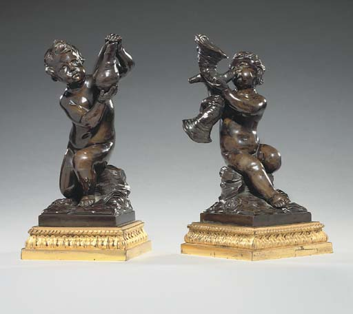 A PAIR OF BRONZE PUTTI