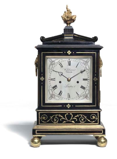 A Regency ebonised and brass-i
