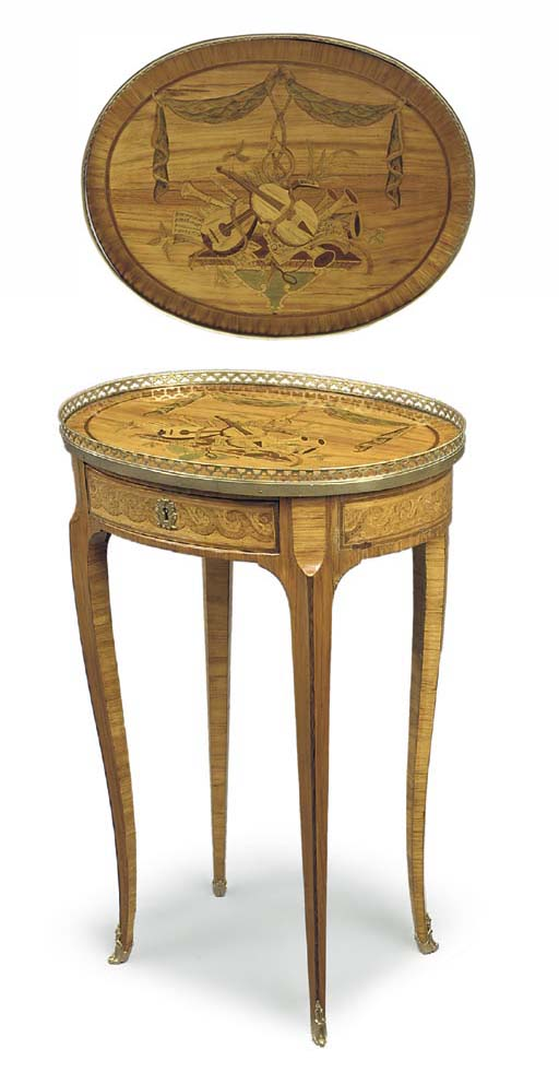 A LOUIS XV ORMOLU-MOUNTED TULIPWOOD AND MARQUETRY CENTRE TABLE