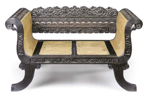 A SINGHALESE CARVED EBONY SMAL