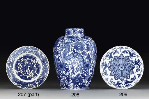 A DUTCH DELFT BLUE AND WHITE VASE AND COVER