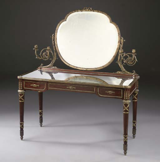 A Louis XVI style ormolu-mounted mahogany dressing-table and mirror
