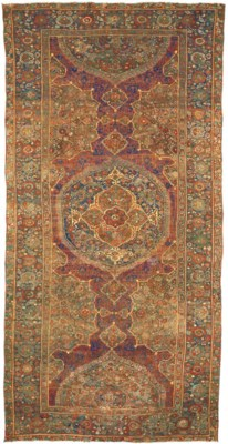 A LARGE MEDALLION USHAK CARPET