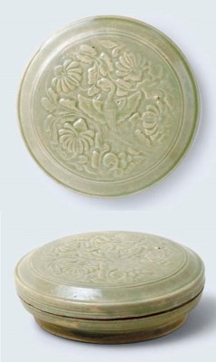 A RARE YUEYAO CARVED CELADON-G