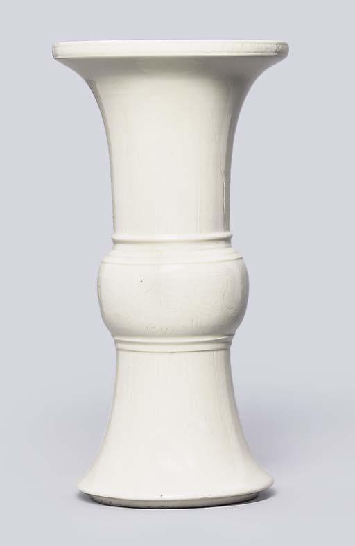 A WHITE-GLAZED INCISED VASE, G