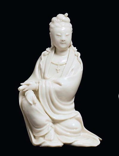 A BLANC DE CHINE SEATED FIGURE