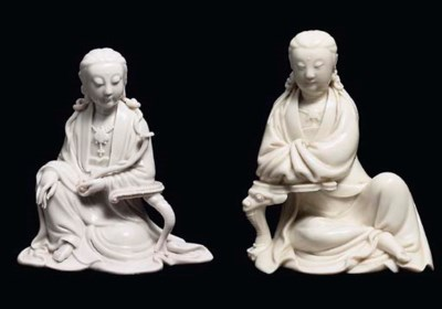 TWO BLANC-DE-CHINE SEATED FIGU