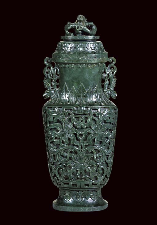 A SPINACH JADE FLATTENED BALUSTER VASE AND DOMED COVER